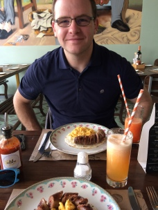 Delicious breakfast of arepa with eggs and chorizo plus juice!